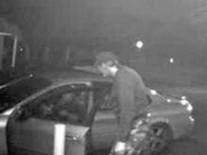 An image from a security camera at a Cash Points ATM in Eastover shows a man who authorities believe robbed a woman at knifepoint at Jan. 23, 2010.