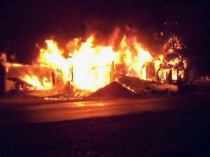 A home on East Moore Street in Fremont erupted in flames on Feb. 10, 2010. (Photo courtesy of Bill Campbell)