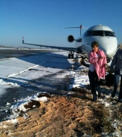 A US Airways plane hit a patch of ice and slid off the taxiway at Charlotte-Douglas International Airport on the morning of Saturday, Feb. 13, 2010, CBS News affiliate WBTV reports. (Photo courtesy of WBTV)