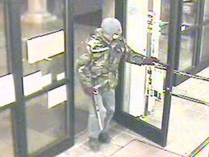 Wake Forest police released this surveillance image from a robbery at the ABC Store on March 17, 2010.