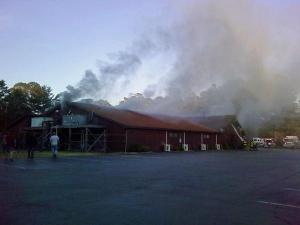Firefighters battle a blaze at Holt Lake Barbecue, at 3506 U.S. Highway 301 South, in Smithfield on Sunday, April 18, 2010.
