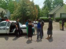 Police talk to potential witnesses after a double shooting in the 600 block of Stratton Way in the late morning of Sunday, April 25, 2010.