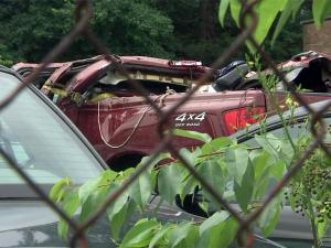 Three cousins died in a crash on Jefferson Davis Highway in Sanford early Saturday, May 29, 2010, and Sanford police were searching for the driver of the burgundy Nissan truck.