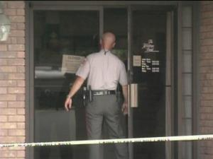 Authorities investigate a robbery at Heritage Bank.