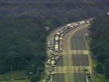 Traffic backs up on Interstate 40 in the area of Fayetteville Road in Durham while police investigate a suspicious object on Wednesday, June 30, 2010.