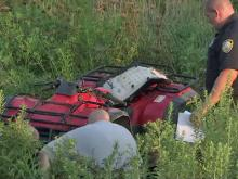 Wake County sheriff's deputies and state troopers examine an ATV abandoned after a chase along U.S. Highway 64 Bypass in Knightdale on Friday, Aug. 20, 2010.