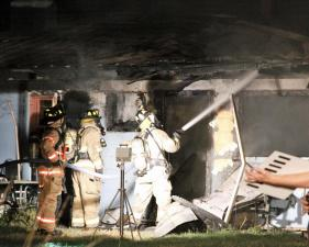Holly Springs firefighters battle a house fire on 634 Bass Lake Road on Saturday, Aug. 22, 2010. One person was in the house when firefighters arrived. He was discovered and brought out to safety. There were no injures, and the house was a total loss. (Photo/Thomas L. Babb)