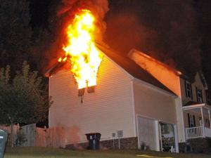Firefighters battle a house fire at 112 Stone Barn Circle in Holly Springs on Saturday. (Photo/Thomas Babb)