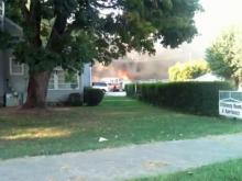 Firefighters are battling a fire at the Harrison Motel at 607 E Chatham St. in downtown Cary on Friday, Sept. 3, 2010. (Photo from video submitted by Eric Forehand)