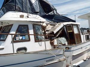 A yacht sustained damage after a collision Saturday with the ferry Carteret off Ocracoke Island.