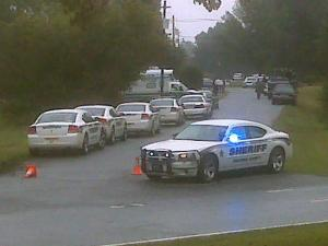 Law enforcement blocks off Green Hill Drive in Siler City on Sept. 29, 2010, as authorities negotiate with an armed man who barricaded himself inside a house and fired at Chatham County deputies.