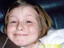Investigators searching for a missing 10-year-old focused Monday on an area where her stepmother used to live.
