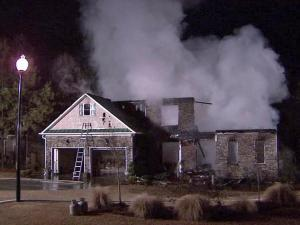 A fire destroyed an unoccupied house in the Winston Pointe subdivision, off Guy Road, in Clayton early Friday, Feb. 4, 2011.