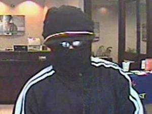 A masked man robbed a SunTrust bank on Pleasant Valley Road in Raleigh on March 11, 2011.