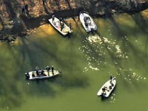 Wake County authorities said two fishermen found the body of a camper a few feet from the Falls Lake shoreline near the Shinleaf Recreation Area near Wake Forest on March 17, 2011.