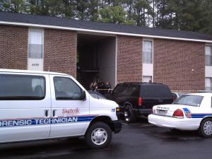 Fayetteville police respond to a shooting at 6539 Jeffrey Drive on May 12, 2011.