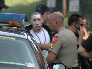 Orange County sheriff's deputies take a man into custody after a manhunt for two men involved in a shooting at a deputy.