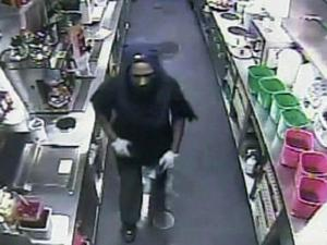 Cumberland County sheriff's deputies released surveillance video from an early morning robbery at a Spring Lake restaurant where an employee was beaten with a handgun on June 20, 2011.