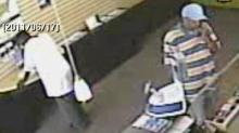 Durham police released surveillance photos of two men they say robbed  Hello Wireless, 1213 University Drive and put pepper spray on a female clerk around 1:30 p.m. on June 17, 2011.