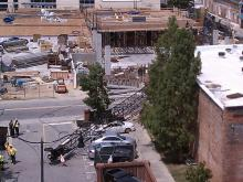 A crane being used to build a parking deck in downtown Fayetteville collapsed Wednesday afternoon, police said.