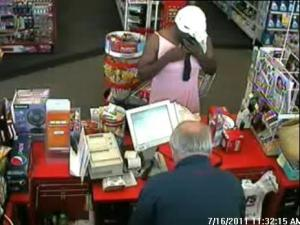 Fayetteville police are trying to identify this man, who robbed a CVS pharmacy at 404 Ramsey St. on Saturday, July 16, 2011, while wearing a pink dress.