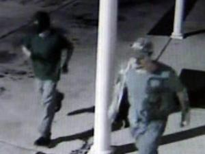 Cumberland County authorities are searching for two men, shown here in an image from a security video, who damaged one bus and stole a second from the Pamper, Hugs and Luv Daycare Center, at 634 Sandhill Road in Hope Mills, on July 20, 2011.
