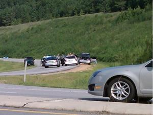 Clayton police officers and Johnston County sheriff's deputies searched around U.S. Highway 70 Bypass and Ranch Road for a suspect in an armed robbery on Commodore Street early Friday, July 29, 2011.