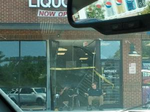 Two masked men drove a gray pickup truck into the Tobacco World and ABC stores in the Ravenstone Commons shopping center, at 121 Sherron Road, early Friday, July 29, 2011, police said. (Viewer-submitted photo)