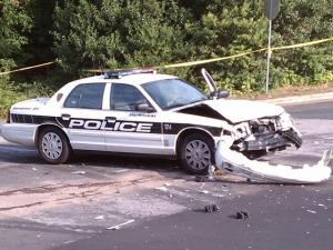 A 15-passenger van struck a Durham police cruiser at Fern and Chester streets Wednesday, Aug. 3, 2011, police said.