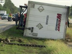 State troopers said that a southbound tractor-trailer flipped over in the median near Exit 79 to N.C. Highway 50 in Benson around 6:40 a.m. Wednesday, Sept. 28, 2011.