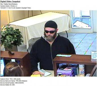 Mebane police released this surveillance photograph of a man who robbed Fidelity Bank, 1296 S. Fifth St., around 11 a.m. on Monday, Oct. 3, 2011.