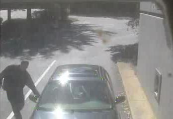 Cary police released this surveillance photo of a man who tried to rob the occupants of a car outside a BB&T bank, at 848 Southeast Maynard Road, shortly after noon Wednesday, Oct. 5, 2011.