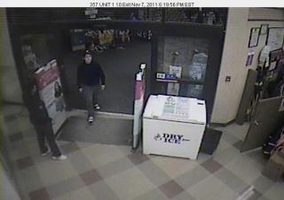 Apex police released surveillance images of a man who robbed a SunTrust Bank inside a grocery store on Monday evening, in the hopes that someone will come forward and identify him.