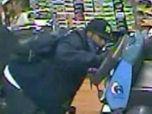 Surveillance images show suspects in a shooting in Raleigh on Dec. 2, 2011.