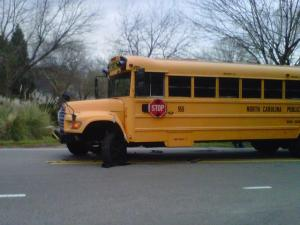 A bus headed to Daniels Middle School collided with a red Chevrolet Cavalier on Lead Mine Road, at Valley Estates Drive, shortly before 7 a.m. on Monday, March 5, 2011.