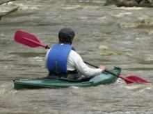 Man, kids rescued after canoe capsizes