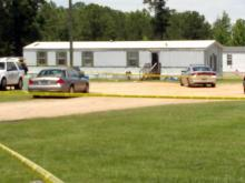 Harnett County authorities investigate a June 6, 2012, shooting in a home on Pine Hollow Drive, off U.S. Highway 421, that killed a woman.
