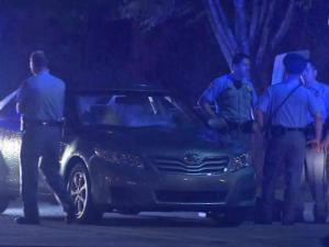 Raleigh police surrounded a car in the parking lot at Time Warner Cable Music Pavilion.