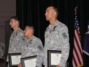 From left: Capt. Shawn Jokinen, Sgt. 1st Class Juan Cando and Staff Sgt. Arnulfo Benitez of the 98th Civil Affairs Battalion (Airborne) received Purple Heart medals in a ceremony at Fort Bragg on Aug. 15, 2012.