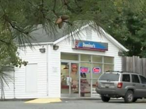 A man exchanged gunfire with a manager while trying to rob a Domino's Pizza store at 3001 Holloway St. in Durham around 8:30 p.m. Saturday, Oct. 13, 2012.