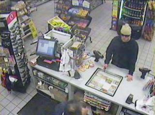 This security camera photo shows a man robbing the Circle K on June 22, 2011.