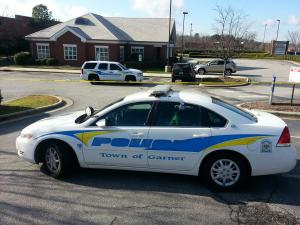 Garner police respond to a robbery at Fifth Third Bank on U.S. Highway 70 on Saturday afternoon, Dec. 29, 2012.