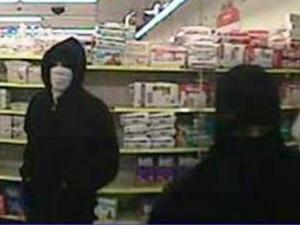 Security video captured this image of two robbers who stole a cellphone and wallet from a man shopping in the Dollar General