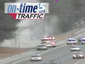 Smoke pours onto Interstate 40 near Trailwood Drive from one of three brushfires set Sunday, Jan. 6, 2013.