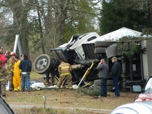 The driver of a tractor-trailer died Tuesday when his rig overturned near Robbins, authorities said. Photo courtesy of AberdeenTimes.com