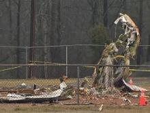 The pilot of a small cargo plane died early Wednesday after the plane crashed into a baseball field at a park near the intersection of Sharpe Road and Melrose Drive in Burlington, police said.