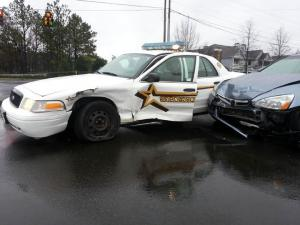 A Durham County deputy's patrol car was side-swiped on Feb. 26, 2013, at the intersection of Page Road and T.W. Alexander Drive as he responded to a chase that began in Granville County.