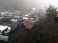 Nearly 100 vehicles crashed Sunday along a mountainous, foggy stretch of interstate near the Virginia-North Carolina border, killing three people and injuring 25 others.