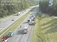 A traffic camera captured this image of a rollover wreck on Interstate 85 that briefly trapped a family of five.
