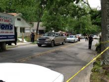 Durham police respond to a shooting in the 100 block of North Hyde Park Avenue on June 18, 2013.